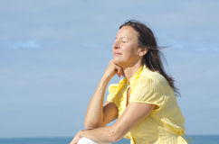 Relaxed meditating woman outdoor Royalty Free Stock Photos
