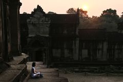 Relaxed meditation at sunrise in the ancient temples stock image