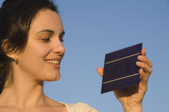 Brunette woman with a solar cell Stock Images