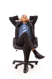 Relaxed middle aged business man. Seated on a chair isolated on white Stock Photo