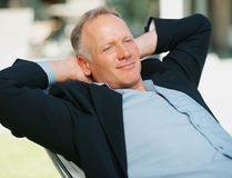 Relaxed middle aged business man in a recliner Stock Photography