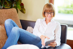 Relaxed middleaged women with pad Royalty Free Stock Image