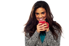 Relaxed mixed race woman having coffee Royalty Free Stock Images