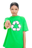 Relaxed model wearing recycling tshirt pointing at camera Stock Images