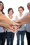 Relaxed models joining hands in a circle Stock Image