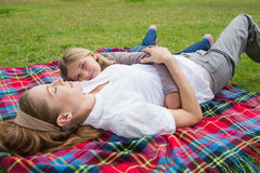 Relaxed mother and daughter lying at park Royalty Free Stock Photos