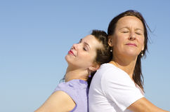 Relaxed mother and daughter together Stock Photos