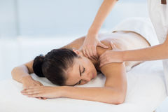 Relaxed naked woman receiving back massage Royalty Free Stock Photos
