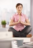 Relaxed office worker meditating Stock Image