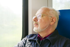 Relaxed Old Man Sitting Near The Window In The Carriage Stock Images