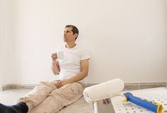 Relaxed painter taking a tea Royalty Free Stock Images