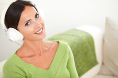 Relaxed peaceful woman listenting to music Stock Images