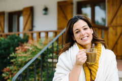 Relaxed pensive woman outside home on autumn Stock Photography