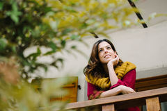 Relaxed pensive woman outside home on autumn Royalty Free Stock Images