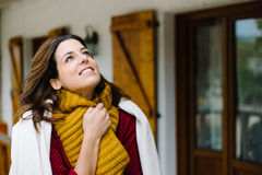 Relaxed pensive woman outside home on autumn Stock Image