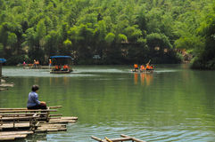The relaxed people in bamboo forest. The relaxed people was fishing and boating on the lake and bamboo forest which in ChangNing County of Sichuan province,China Royalty Free Stock Image