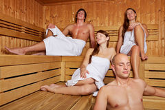 Relaxed people sitting in sauna Royalty Free Stock Images