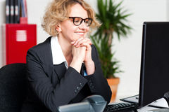 Relaxed portrait of beautiful aged corporate woman royalty free stock photo