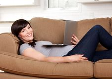 Relaxed Pregnant Woman with Computer Stock Photo