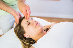 Relaxed pregnant woman enjoying head massage Royalty Free Stock Photos