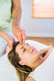 Relaxed pregnant woman enjoying head massage Stock Images