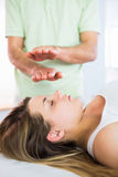 Relaxed pregnant woman getting reiki treatment Stock Photo