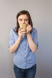 Relaxed pretty brunette drinking coffee Stock Images
