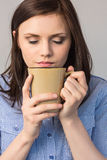 Relaxed pretty brunette smelling coffee Royalty Free Stock Image