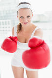 Relaxed pretty sportswoman boxing the camera Stock Photography