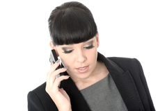 Relaxed Professional Business Woman Talking On Cell Phone. Relaxed professional business Woman with black hair and hispanic or european features, looking down Royalty Free Stock Photos