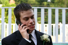Relaxed Prom Boy On Phone Horizontal. Horizontal closeup of a relaxed teenage boy in a prom tux talking on a cell phone in an outdoor setting Stock Photos