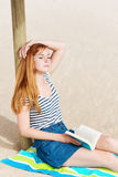 Relaxed Redhead Woman With Book On Beach Stock Images