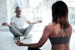 Relaxed retired man enjoying yoga class Stock Photos