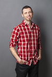 Relaxed 40s man wearing goatee and checked shirt Royalty Free Stock Photos