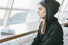 Relaxed sad calm young girl in hoodie. Profile side portrait royalty free stock photo