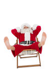 Relaxed santa stiting on deckchair Royalty Free Stock Image