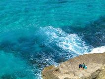 Relaxed seaside angler Stock Image