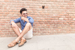 Relaxed seated casual man looking to his side Stock Image