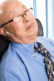 Relaxed senior asian businessman Stock Photos