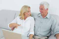 Relaxed senior couple using laptop at house Royalty Free Stock Images