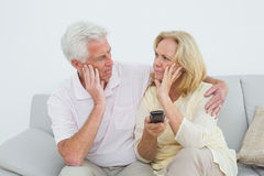 Relaxed senior couple watching television Stock Photos
