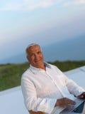 Relaxed senior man on balcony Royalty Free Stock Image