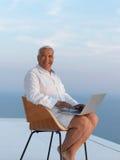 Relaxed senior man on balcony Stock Photos