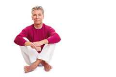 Relaxed senior man sitting Stock Photo
