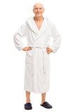Relaxed senior man in a white bathrobe Royalty Free Stock Photos