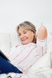 Relaxed senior woman with book Royalty Free Stock Image