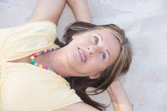 Relaxed senior woman enjoying retirement Royalty Free Stock Image