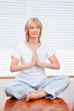 Relaxed senior woman meditating Royalty Free Stock Photography