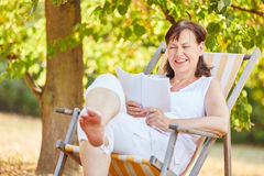 Relaxed senior woman reading Royalty Free Stock Photos