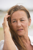 Relaxed serious attractive senior woman Stock Photography